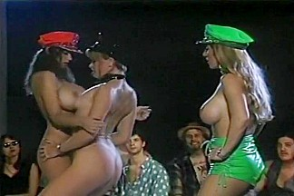 Three Strippers Do Their Best To Tease The Crowd