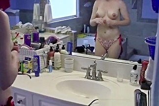 Girlfriend dressing bikini in bathroom