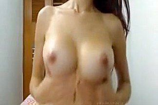 Hot brunette slut on webcam teasing and seducing with her sexy body