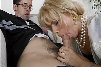 Trashy mature c-cup golden-haired sucks juvenile mate's knob then that fella licks her fur pie