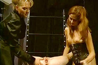 Stern dominant-bitch overlooking two hawt slaves in SADOMASOCHISM act